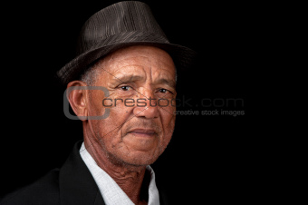 Serious old man with hat
