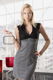 blonde business woman with hand on the hip