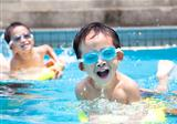 asian boy in swimming pool