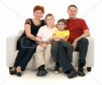 Family of four on a sofa