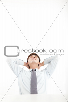 relaxed businessman looking up