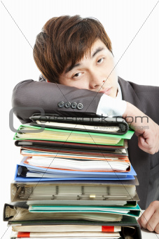 tired Businessman with  paperwork