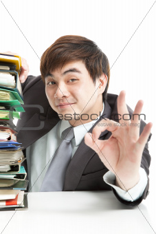 smart businessman with ok gesture in the office