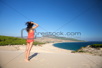 woman at top of Bolonia beach
