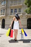 woman with hat and shopping bags