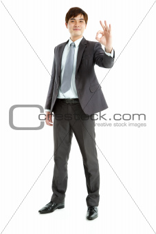 full length of smart  Businessman with ok gesture