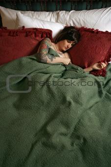 Beautiful woman with tattoos sleeping