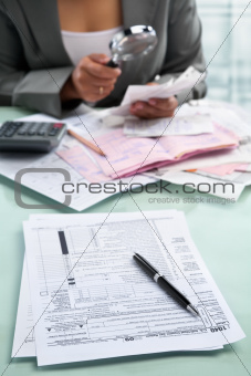 Tax form and businesswoman