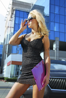 blonde businesswoman with pink folder