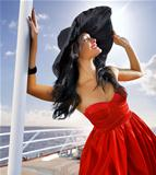 beautiful woman in red dress on the yacht