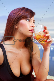 brunette woman with glass of whisky