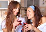 Happy women drinks wine