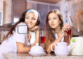 Happy women on kitchen
