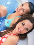 Young girls in jacuzzi