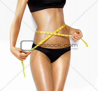 beautiful woman measuring perfect shape