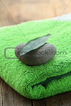 green towel, stone and leaf Zen Concept