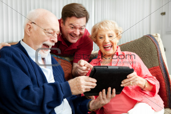 Family Uses Tablet PC and Laughs