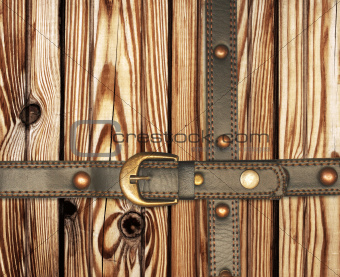 Old wooden boards and leather belt