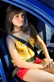 girl in car fastened by seat belt