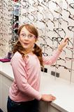young girl choosing glasses