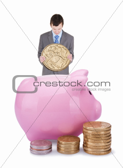 Young businessman with pigggy bank