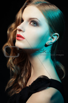 Glamorous ginger girl with over black background