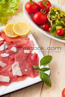 Carpaccio and basket of Parmesan with veggies