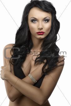 beautiful girl with long wavy hair and dark bra