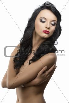 beautiful girl with long wavy hair looks down