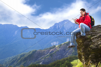 man with tablet pc on the mountain