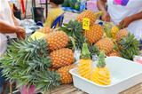 Pineapples on outdoor fruit market