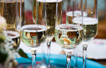 Golden champagne sparkle with fluted glasses and party ribbons