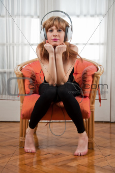 Beautiful young woman listening to the music