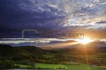English landscape with sun lighting side of hills