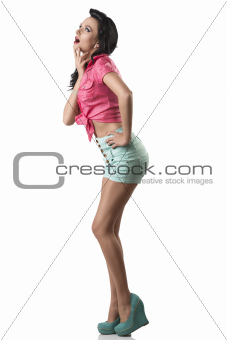 pretty brunette with shorts with expression of surpraise