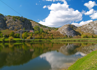 Mountain lake with a blue sky
