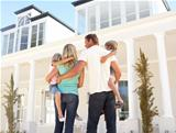Young Family Standing Outside Dream Home