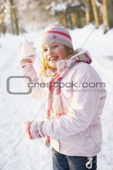 Girl About To Throw Snowball In Snowy Woodland
