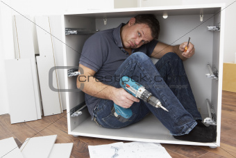 Image 4791961 man trapped whilst assembling flat pack furniture from crestock stock photos - Diy tips assembling flat pack furniture ...