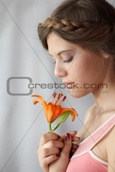 beauty portrait of a woman and with flower