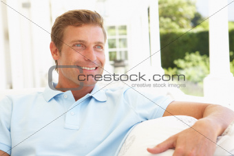 Portrait Of Young Man Relaxing On Sofa