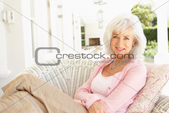 Portrait Of Senior Woman Relaxing In Chair