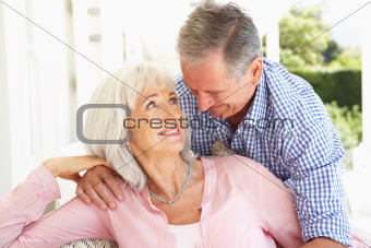 Portrait Of Senior Couple Relaxing Together On Sofa