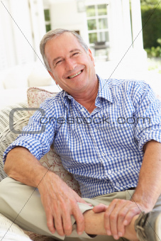 Portrait Of Senior Man Relaxing In Chair