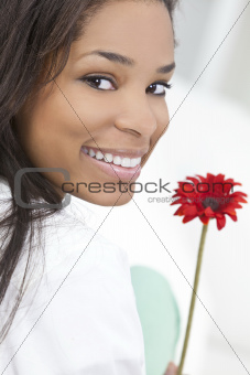 African American Woman Smiling with Red Flower