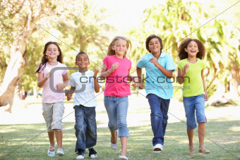Group Of Children Running Through Park