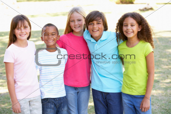Portrait Of Group Of Children Playing In Park