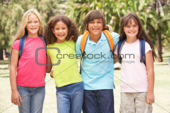 Group Of Schoolchildren Standing In Park