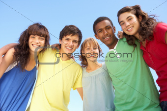 Group Of Teenage Friends Standing Outside