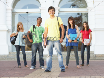 Group Of Teenage Students Standing Outside College Building